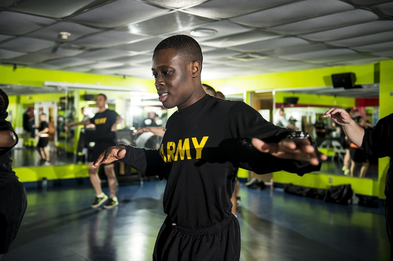 U.S. Army Reserve Soldiers from the 200th Military Police Command participate in a Zumba fitness class during a Performance Triad program organized by the command and hosted on Fort Meade, Maryland, May 9, 2017. The three-week fitness program took place from May 5-25 to help Soldiers who had either failed the Army Physical Fitness Test or had been on the Army Body Fat Composition program. The camp focused on the triad of overall health: physical fitness, nutrition and sleep, by providing education and personalized coaching to Soldiers in all three of those phases of life and more. (U.S. Army Reserve photo by Master Sgt. Michel Sauret)