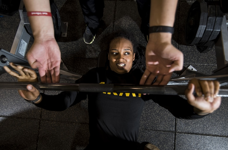 Spc. Jasmine Kearse, a U.S. Army Reserve Soldier from the 200th Military Police Command, bench-presses with the help of a spotter during a Performance Triad program organized by the command and hosted on Fort Meade, Maryland, May 9, 2017. The three-week fitness program took place from May 5-25 to help Soldiers who had either failed the Army Physical Fitness Test or had been on the Army Body Fat Composition program. The camp focused on the triad of overall health: physical fitness, nutrition and sleep, by providing education and personalized coaching to Soldiers in all three of those phases of life and more. (U.S. Army Reserve photo by Master Sgt. Michel Sauret)