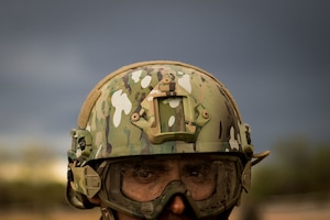 A Peruvian air force security forces airman scans his sector during an isolated personnel scenario for exercise Angel Thunder 17 in Florence, Ariz., May 9, 2017. Angel Thunder is a two-week, Air Combat Command-sponsored, joint certified and accredited personnel recovery exercise focused on search and rescue. The exercise is designed to provide training for personnel recovery assets using a variety of scenarios to simulate deployment conditions and contingencies. (U.S. Air Force photo by Tech. Sgt. Larry E. Reid Jr.)