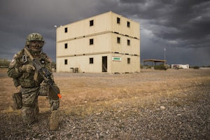 A Peruvian Air Force security forces Airman provides perimeter security during an isolated personnel scenario for exercise Angel Thunder 17 in Florence, Ariz., May 9, 2017. Angel Thunder is a two-week, Air Combat Command-sponsored, joint certified and accredited personnel recovery exercise focused on search and rescue. The exercise is designed to provide training for personnel recovery assets using a variety of scenarios to simulate deployment conditions and contingencies.