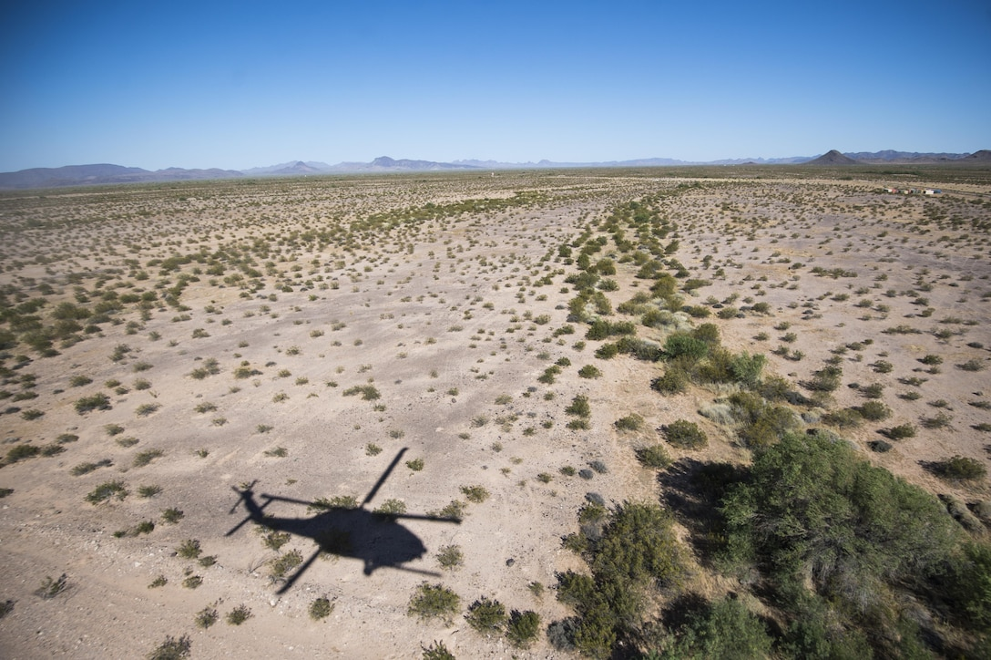An HH-60 Pave Hawk assigned to the 66th Rescue Squadron hovers over the location of the isolated personnel during a search and rescue scenario at exercise Angel Thunder 17 in Gila Bend, Ariz., May 13, 2017. Angel Thunder is a two-week, Air Combat Command-sponsored, joint certified and accredited personnel recovery exercise focused on search and rescue. The exercise is designed to provide training for personnel recovery assets using a variety of scenarios to simulate deployment conditions and contingencies. (U.S. Air Force photo by Tech. Sgt. Larry E. Reid Jr.)
