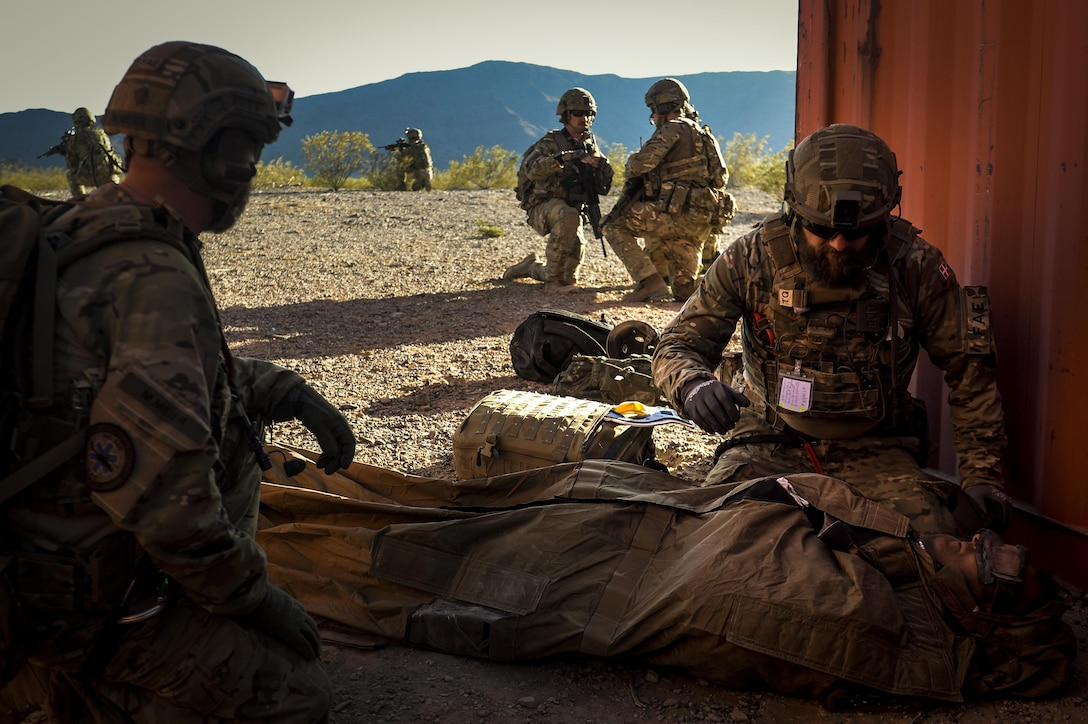 Royal Danish Air Force forward aeromedical evacuation technicians from the 660th Forward Support Squadron treat a simulated patient during a personnel recovery mission during Angel Thunder 17 at Gila Bend, Ariz., May 13, 2017. Angel Thunder is a two-week, Air Combat Command-sponsored, joint certified and accredited personnel recovery exercise focused on search and rescue. The exercise is designed to provide training for personnel recovery assets using a variety of scenarios to simulate deployment conditions and contingencies. (U.S. Air Force photo by Staff Sgt. Corey Hook)