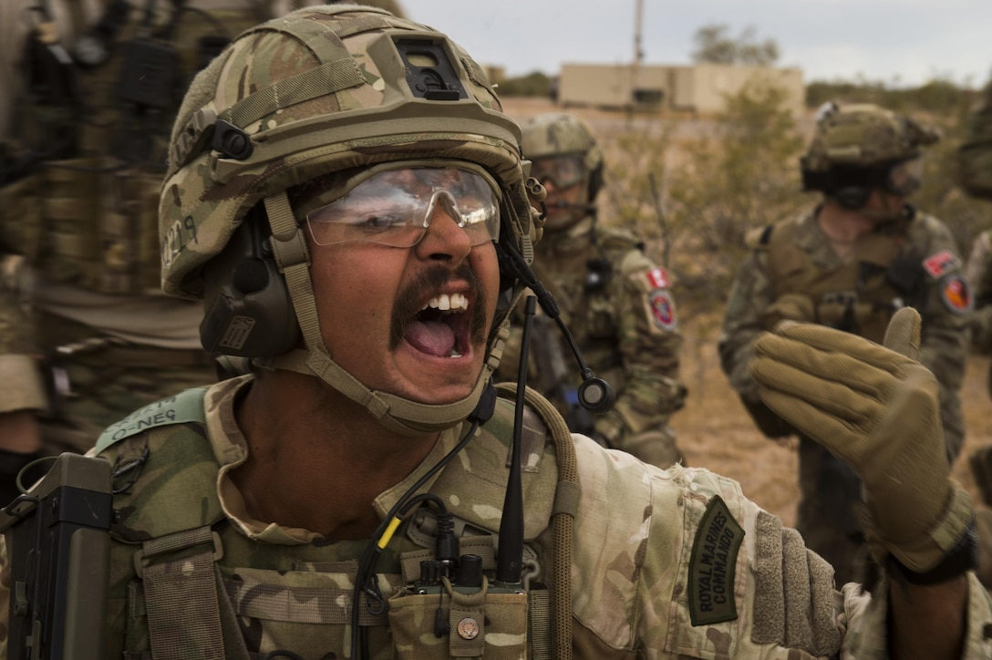 A Royal Marine Commando communicates with his security team during an isolated personnel scenario at Angel Thunder 17 in Florence, Ariz., May 9, 2017. Angel Thunder is a two-week, Air Combat Command-sponsored, joint certified and accredited personnel recovery exercise focused on search and rescue. The exercise is designed to provide training for personnel recovery assets using a variety of scenarios to simulate deployment conditions and contingencies. (U.S. Air Force photo by Tech. Sgt. Larry E. Reid Jr.)