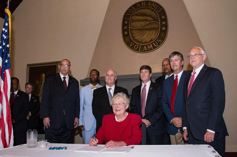 Alabama Governor Kay Ivey signs legislation benefiting Alabama's military members at a special ceremony, May 23, 2017, Maxwell Air Force Base, Ala. The bills covered a variety of subjects including Guardsmen employment rights, recruiter access to state educational institutions, Guard bill for college scholarships for dependents of disabled veterans, and expansion of military industrial access funds to installation roads, bridges, and power lines (US Air Force photo by Melanie Rodgers Cox/Released)