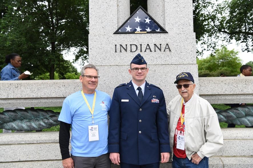First Lt. Nicholas Lundin, 480th Intelligence, Reconnaissance and Surveillance Wing chief of current operations, stands between his dad Michael Lundin and grandfather Ray Lundin after his promotion ceremony May 24, 2017 at the World War II memorial in Washington D.C. Lundin's grandfather served in the Pacific for the U.S. Navy during World War II and was selected to travel to the nation's Capital through an Honor Flight program in Northeast Indiana. The program affords WWII veterans the opportunity to fly for free to visit and reflect at their respective memorial. (U.S. Air Force photo by Tech. Sgt. Darnell T. Cannady)