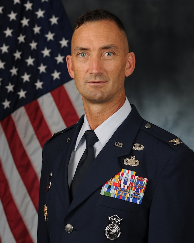 Air Force Col. Troy A. Roberts, 11th Security Forces Group commander poses for an official photo.