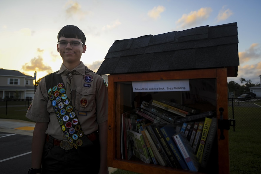 """Aiden Holt, a Boy Scout with Boy Scout Troop 509 on Hurlburt Field, poses for a photo at Hurlburt Field, Fla., May 23, 2017. Holt built three Little Free Libraries on Hurlburt. A Little Free Library is a """"take a book, leave a book"""" free book exchange. Anyone is encouraged to take, exchange or leave a book for others to read and expand their literacy. (U.S. Air Force photo by Airman 1st Class Dennis Spain)"""