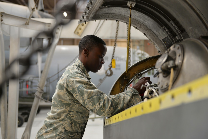 Airmen Scottie Reed, 361st Training Squadron students learn how to install the reduction gear box onto a T-56 engine at Sheppard Air Force Base, Texas, May 23, 2017. This training course lasts 15 weeks with a total of nine blocks.(U.S. Air Force photo by Liz H. Colunga/Released)