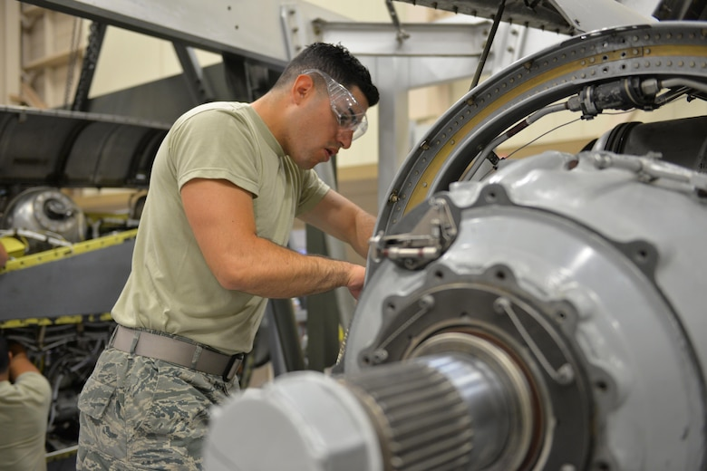 Airmen Antony Miranda, 361st Training Squadron student learns how to install the reduction gear box onto a T-56 engine at Sheppard Air Force Base, Texas, May 23, 2017. This training course lasts 15 weeks with a total of nine blocks.(U.S. Air Force photo by Liz H. Colunga/Released)