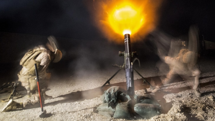 Marines fire one of 120 mm illumination mortar rounds to set a base plate into the ground at Bost Airfield in Lashkar Gah, Afghanistan, May 22, 2017. Marine Corps photo by Sgt. Justin T. Updegraff