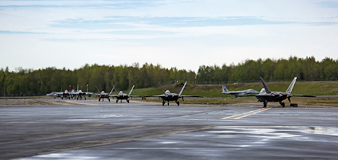 U.S. Air Force and Marine Corps aircraft prepare to conduct flight operations during exercise Distant Frontier at Joint Base Elmendorf-Richardson, Alaska, May 23, 2017. Distant Frontier is a unit-level training iteration designed to sharpen participants' tactical combat skills and develop interoperable plans and programs across the joint force. (U.S. Marine Corps photo by 1st Lt. Melissa M. Heisterberg)