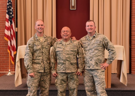 90th Missile Wing Chaplains (from left to right) Samuel McClellan, James Calledo, Thomas Fussell. Stand join together at the High Plains Chapel at F.E. Warren Air Force Base, Wyo., May 23, 2017. The chaplains served the Mighty Ninety for 3 years together and are now leaving for new assignments.  (U.S. Air Force photo by Terry Higgins)