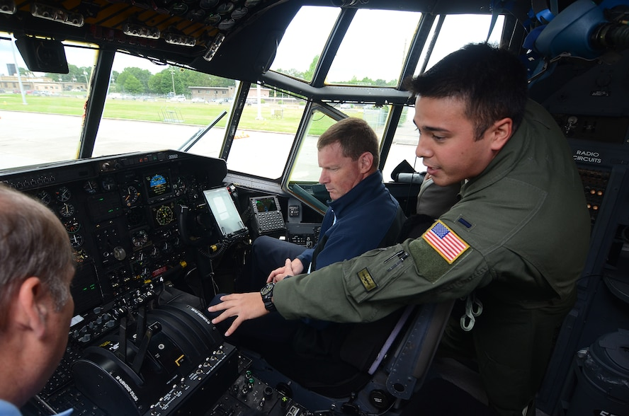 "1st Lt. William Jones, 700th Airlift Squadron C-130 pilot, showcases a C-130 Hercules cockpit to members of the Honorary Commanders Association Class of 2017 during their annual ""Dobbins Day"" May 25, 2017 at Dobbins Air Reserve Base, Georgia. The HCA annually selects community and business leaders and pairs them with military commanders in a yearlong program, giving the leaders the opportunity to learn more about local military activities, their impact on our economy and various aspects of the national defense system. (U.S. Air Force photo/Don Peek)"