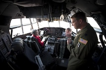 Secretary of the Air Force Heather Wilson engages with pilots assigned to the 302nd Airlift Wing in the cockpit of a C-130 Hercules aircraft during her first base visit to Peterson Air Force Base, Colo., May 22, 2017. Wilson toured Peterson AFB on her first official base visit as secretary and learned about the numerous mission partners housed on the base. (U.S. Air Force photo by Airman 1st Class Dennis Hoffman)