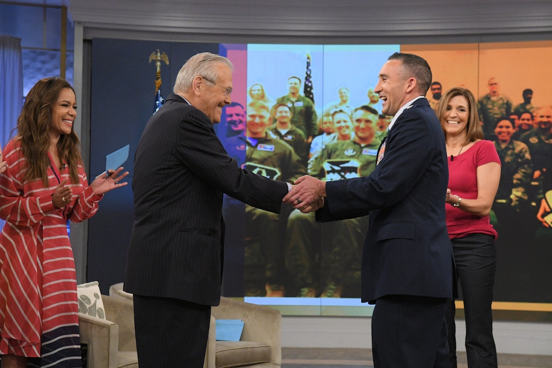 """Former U.S, Secretary of Defense, Donald Rumsfeld congratulates Lt. Col. Thomas """"Brock"""" Lessner on the set of """"The View"""" on May 25 following his on-air promotion to lieutenant colonel. . He appeared on the show in support of a larger Memorial Day tribute featuring Rumsfeld as the guest host. Lessner shared his story of resilience that helped him and his family overcome many challenges, including a rocket propelled grenade strike on his helicopter during Operation Iraqi Freedom. (ABC courtesy photo)."""