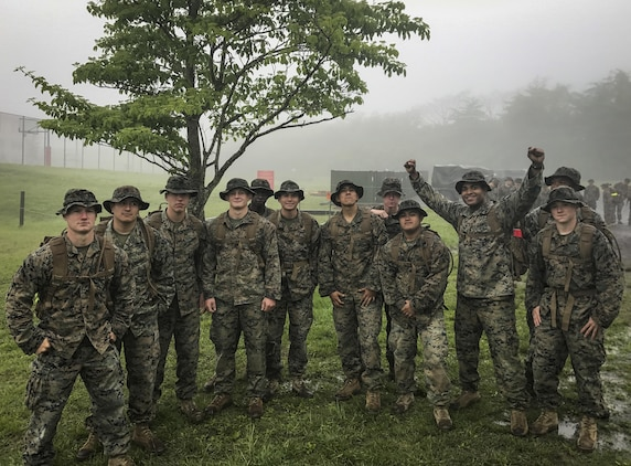 Marines stand together at the end of the 50-mile hike challenge on, May 17, 2017, at Combined Arms Training Center Camp Fuji, Japan. The 50-mile hike challenge dates back to 1908 when President Theodore Roosevelt signed Executive Order 989 requiring lieutenants and captains in the Marine Corps to walk 50-miles in no more than 20 hours. The Marines are with 3rd Battalion, 8th Marine Regiment forward deployed from Camp Lejeune, North Carolina to III Marine Expeditionary Force under the unit deployment program. (Photo courtesy of Maj. Patrick Murray)