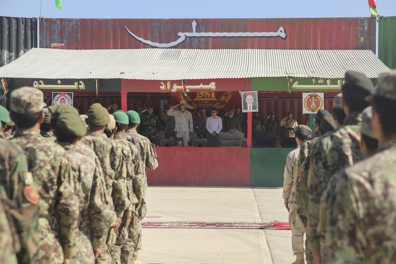 U.S. Marines with Task Force Southwest and Afghan National Army soldiers with the 215th Corps salute during the playing of the Afghan National Anthem at Camp Shorabak, Afghanistan, May 20, 2017. Service members from both nations gathered for an opening ceremony recognizing 2nd Kandak, 4th Brigade's commencement of the operational readiness cycle, an eight-week training program which builds the infantry and warfighting capabilities of the Afghan soldiers. Approximately 15 Marine advisors will assess and make recommendations to the Afghan trainers as part of the Task Force's train, advise and assist mission in Helmand Province. (U.S. Marine Corps photo by Sgt. Lucas Hopkins)