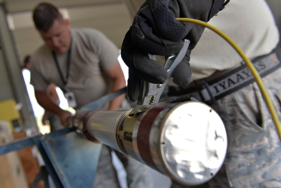 U.S. Air Force Tech. Sgt. Michael Postel (left), 447th Expeditionary Aircraft Maintenance Squadron (EAMXS) production superintendent, and Tech. Sgt. Jeremiah Webb, 447th EAMXS maintenance supervisor, assemble an Advanced Precision Kill Weapon System (APKWS) rocket, May 24, 2017, at Incirlik Air Base, Turkey. The APKWS rocket is designed to give warfighters low-cost surgical strike capability. (U.S. Air Force photo by Senior Airman John Nieves Camacho)
