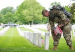 """Soldiers from the 3rd U.S. Infantry Regiment (The Old Guard) participate in the """"Flags-In"""" mission at Arlington National Cemetery, Va. May 25, 2017. Soldiers placed an American flag at every grave maker in the cemetery. The Old Guard has conducted this mission annually at Arlington National Cemetery prior to Memorial Day. Army photo by Sgt. Nicholas T. Holmes"""