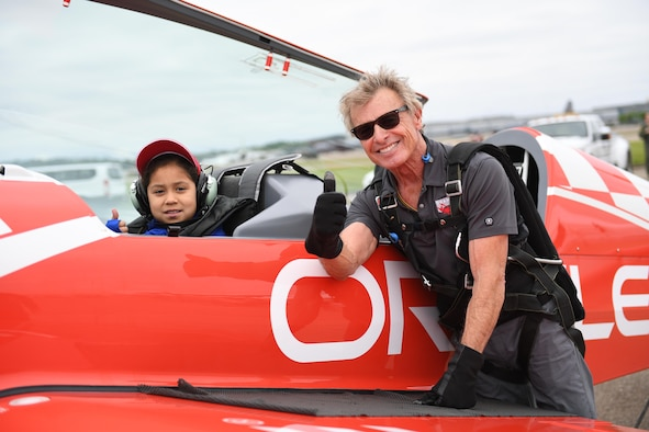 Evangelina Johnston, winner of the Young Eagles Essay Contest, and Sean D. Tucker, airshow performer with Team Oracle, give thumbs up after a flight at the Pittsburgh International Airport Air Reserve Station, Pa., May 12, 2017. Johnston had just landed from an incentive flight with Tucker on his Team Oracle aircraft while he was in town for the 2017 Wings Over Pittsburgh Open House/ Airshow, her award for placing first in the essay contest. (U.S. Air Force photo by Senior Airman Beth Kobily)