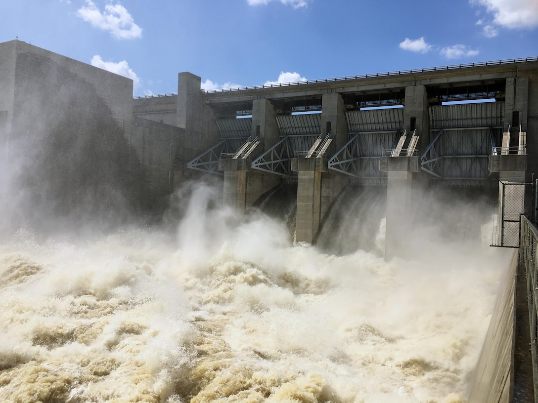 Truman Lake releases 12K cubic feet per second through the two power generation units and an additional 38K cfs through the tainter gates (pictured). We are coordinating with Ameren to maintain target levels in the Osage River.   These releases are needed to get the lake back to a state where it can receive more water from the next rain events.