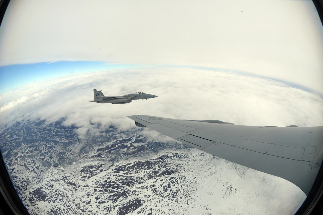 A U.S. Air Force F-15E Strike Eagle from RAF Lakenheath, England, flies alongside a U.S. Air Force KC-135 Stratotanker from RAF Mildenhall following aerial refueling over Finland, May 25, 2017. Both aircraft are participating in Arctic Challenge 2017, a multinational exercise encompassing 11 nations and more than 100 aircraft. (U.S. Air Force photo by Tech. Sgt. David Dobrydney)