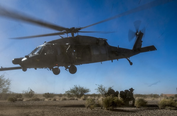 An HH-60 Pave Hawk drops off pararescuemen with the 58th Rescue Squadron during a personnel recovery scenario at Angel Thunder 17 in Gila Bend, Ariz., May 13, 2017. Angel Thunder is a two-week, Air Combat Command-sponsored, joint certified and accredited personnel recovery exercise focused on search and rescue. The exercise is designed to provide training for personnel recovery assets using a variety of scenarios to simulate deployment conditions and contingencies. (U.S. Air Force photo/Staff Sgt. Marianique Santos)