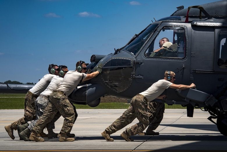 Airmen from the 41st Helicopter Maintenance Unit push an HH-60G Pave Hawk into a C-17 Globemaster III, May 15, 2017, at Moody Air Force Base, Ga. Loading the helicopter for transport was the first step in a rapid-rescue exercise conducted at Langley AFB, Va., which was designed to test the maintainer's and aircrew's ability to quickly set up and conduct rescue operations away from their home station. (U.S. Air Force photo/Staff Sgt. Ryan Callaghan)