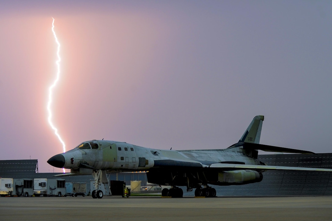 Lightning strikes behind a B-1B Lancer parked on the flight line as a major storm approaches Tinker Air Force Base, Okla. May 18, 2017. The B-1B is at Tinker AFB undergoing depot level maintenance and has been stripped of the majority of its paint. (U.S. Air Force photo/Greg L. Davis)