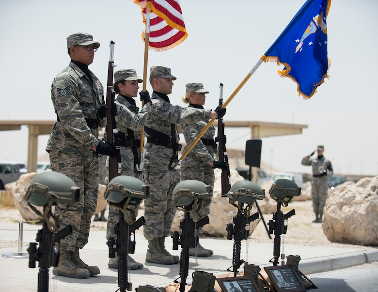 Airmen with the Al Udeid Air Base honor guard present the colors for the final guard mount ceremony at Al Udeid AB, Qatar, May 19, 2017. The final guard mount ceremony is a tradition where all members of 379th Expeditionary Security Forces Squadron pay tribute to fallen security forces Airmen and Air Force Office of Special Investigations agents who died in the line of duty by calling out their names as the flight sergeant conducts roll call. (U.S. Air Force photo/Tech. Sgt. Amy M. Lovgren)