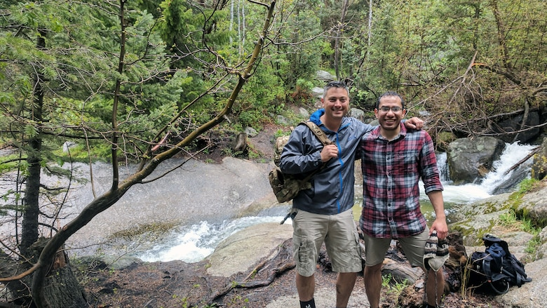 Tech. Sgt. Alister Clyne, left, poses with Marco Mora-Huizar May 21 along the Bells Canyon trail minutes after pulling Mora-Huizar from fast-moving Bells Canyon Creek above Lower Falls. (Courtesy photo)