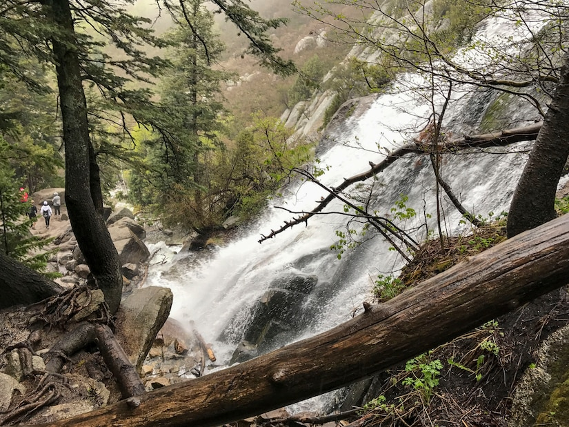 A view of Lower Falls from a path used by hikers to get to the flowing Bells Canyon Creek above. The photo was taken May 21 before Tech. Sgt. Alister Clyne pulled Marco Mora-Huizar from the fast-moving creek. (Courtesy photo)