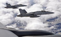 F-18 Hornets of the Finnish Air Force fly alongside a U.S. Air Force KC-135 Stratotanker from RAF Mildenhall, England, during aerial refueling over Finland, May 25, 2017. All three aircraft are participating in Arctic Challenge 2017, a multinational exercise encompassing 11 nations and more than 100 aircraft. (U.S. Air Force photo by Tech. Sgt. David Dobrydney)