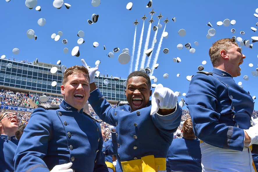 U.S. Air Force Academy graduates cheer at the end of the Class of 2017 graduation ceremony while the Air Force Thunderbirds fly over Falcon Stadium, May 24, 2017. Ninety-three grads are slated to attend grad school now that they've earned bachelor degrees and commissions as second lieutenants. (U.S. Air Force photo/Darcie Ibidapo)