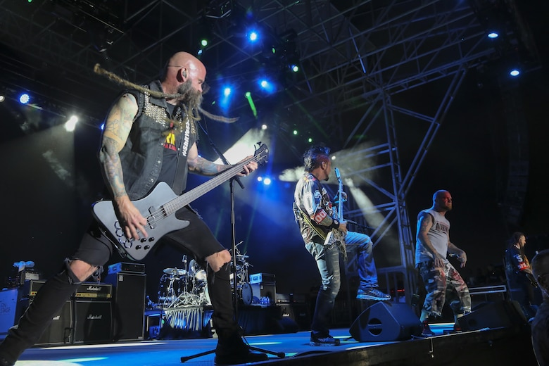 Five Finger Death Punch performs for Combat Center patrons during the We Salute You Celebration at Lance Cpl. Torrey L. Gray Field aboard the Marine Corps Air Ground Combat Center, Twentynine Palms, Calif., May 19, 2017. Marine Corps Community Services hosted the event to provide entertainment to Marines and sailors aboard the Combat Center. (U.S. Marine Corps photo by Lance Cpl. Christian Lopez)