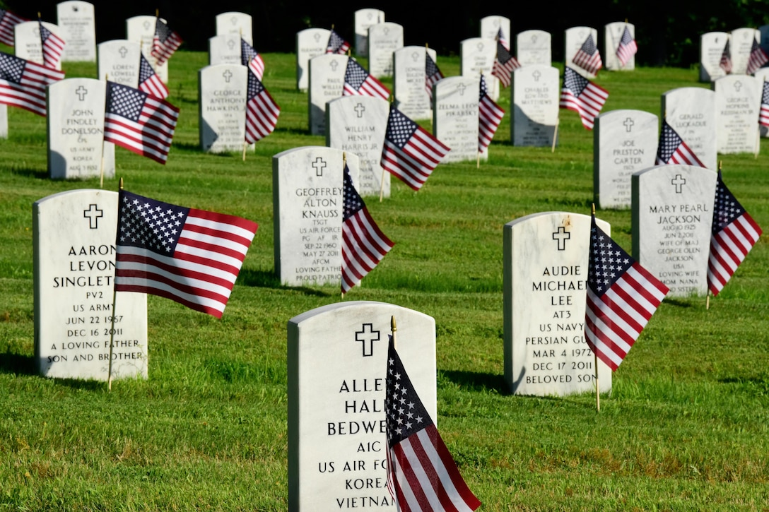 American flags adorn headstones at the Arkansas State Veterans Cemetery