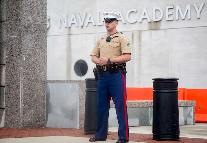 Corporal Austin Aldrich, section leader, Guard Company, Marine Barracks, assumes his post during the 2017 United States Naval Academy Commissioning Week, Annapolis, Md., May 25, 2017.  Guard Marines with Marine Barracks Washington were called upon to support as an additional security element for this year's Commissioning Week. (Official Marine Corps photo by Cpl. Robert Knapp/Released)