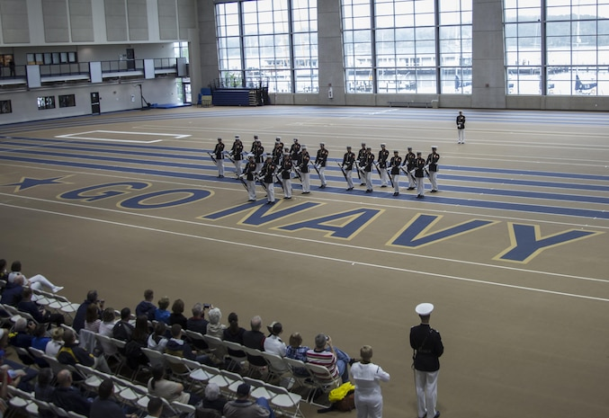 The U.S. Marine Corps Silent Drill Platoon executes precision rifle drill movements during a Battle Color Detachment Ceremony as a part of the 2017 United States Naval Academy Commissioning Week, Annapolis, Md., May 22, 2017. The U.S. Marine Corps Battle Color Detachment performed for hundreds of guests attending this year's Commissioning Week events in which honor the First Class midshipmen upon their completion of their four years at the Academy. (Official Marine Corps photo by Cpl. Robert Knapp/Released)