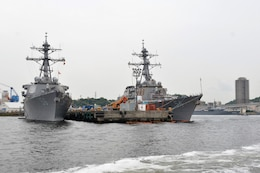 The Arleigh-Burke-class guided-missile destroyers USS John S. McCain (DDG 56) and USS Curtis Wilbur (DDG 54) sit pier-side at Fleet Activities (FLEACT) Yokosuka, May 16, 2017. FLEACT Yokosuka provides, maintains, and operates base facilities and services in support of 7th Fleet's forward-deployed naval forces, 71 tenant commands, and 26,000 military and civilian personnel.