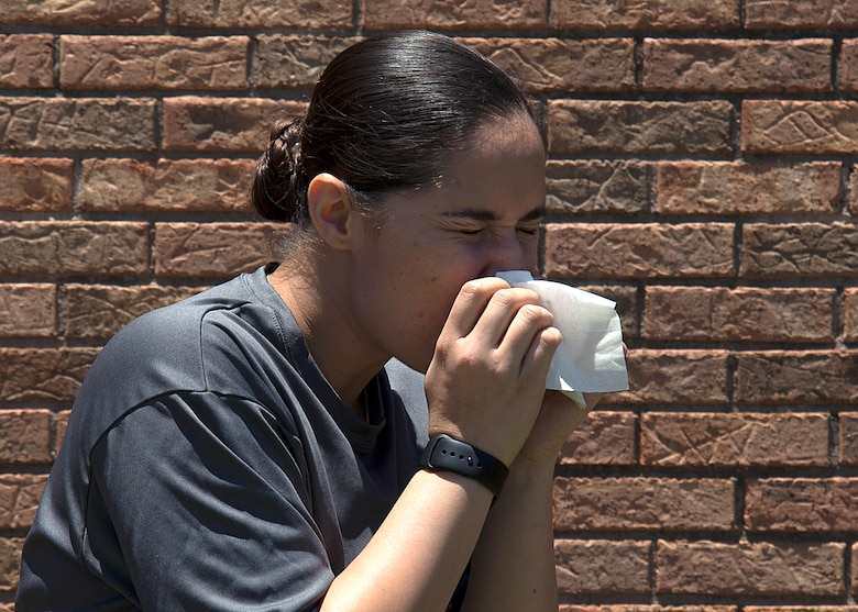 A service member battles allergies at MacDill Air Force Base, Fla., May 26, 2017. In Florida, allergies occur year-round due to the warmer temperatures. (U.S. Air Force photo by Staff Sgt. Brittany Liddon)