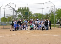 Players from both installations who participated in the Grand Forks AFB versus Minot AFB annual softball tournament May 25, 2017, at Devil's Lake, N.D. gathered together after the final game to take a group picture. Minot took the trophy home, breaking Grand Forks' two-year winning streak. (U.S. Air Force photo by Airman 1st Class Elora McCutcheon)