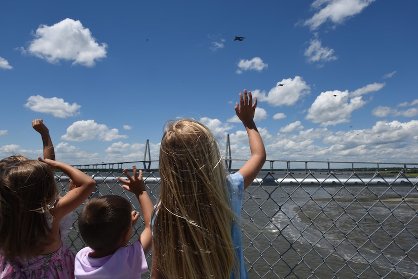A group of children wave to a formation of C-17 Globemaster III aircraft from the 437th Airlift Wing, Joint Base Charleston, South Carolina, as they fly over the Arthur Ravenel Jr. Bridge in support of a global response force exercise on May 25. The multiple C-17 integrated large formation exercise supports the U.S. Army's 82nd Airborne Division's joint forcible entry exercise at Fort Bragg, North Carolina, during their All American Week and 100th Anniversary.