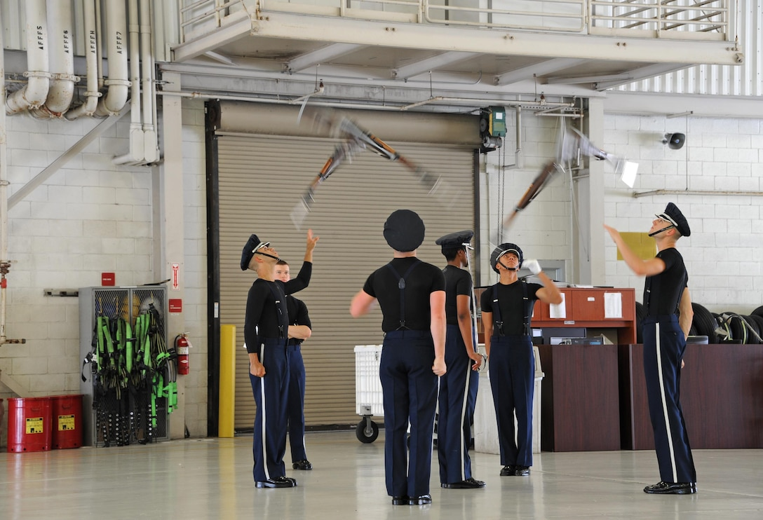 The U.S. Air Force Honor Guard Drill Team, stationed at Joint Base Anacostia-Bolling, Washington, D.C., practices drill movements before a U.S. Armed Forces Delayed Entry Program swear-in ceremony during the Memorial Day weekend National Salute to America's Heroes Miami Air and Sea Show at U.S. Coast Guard Air Station Miami in Opa-Locka, Fla., May 26, 2017. The joint-service event allows the five branches of the Armed Forces to demonstrate and educate the public on their asset's capabilities, and increases awareness and understanding of each branch's unique mission. (U.S. Air Force photo by Senior Airman Erin Trower)
