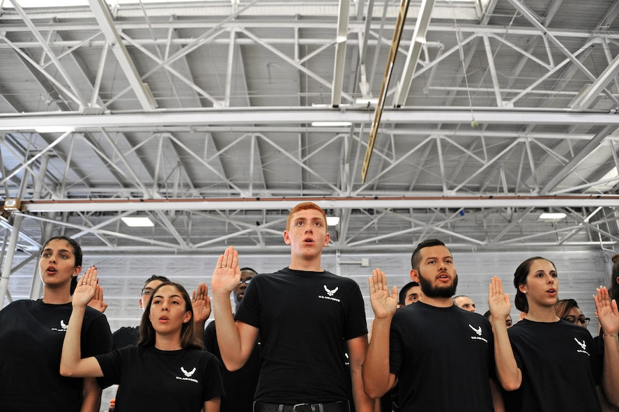 Air Force Delayed Entry Program recruits are sworn in during a U.S. Armed Services swear-in ceremony during the Memorial Day weekend National Salute to America's Heroes Miami Air and Sea Show at U.S. Coast Guard Air Station Miami in Opa-Locka, Fla., May 26, 2017. Department of Defense service members, DEP family members, and guests witnessed approximately 97 Air Force recruits took the Oath of Enlistment, along with Army, Navy, Marine Corps, and Coast Guard recruits. (U.S. Air Force photo by Senior Airman Erin Trower)