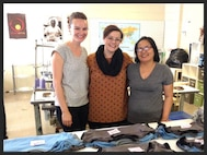"""(Left to right) Evan Menendez, owner of Evan Brooke Ethical Clothing, Emily Sidle, production director, and Thaang Zuali, sewing manager of Open Arms Manufacturing,  lead a """"USA-Made"""" sustainable apparel and sewn goods manufacturer which empowers refugee women through fair-wage employment, located in Austin, Texas (Courtesy photo)"""