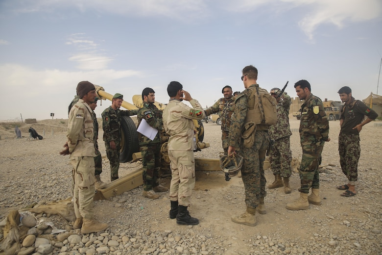 A U.S. Marine advisor with Task Force Southwest speaks with Afghan National Army soldiers with the 2nd Brigade, 215th Corps on artillery capabilities and tactics at Camp Nolay, Afghanistan, May 22, 2017. Several Marine advisors assisted their Afghan counterparts during an expeditionary advising package May 21-25, providing force sustainment recommendations as well as assisting in the coordination of a clearing operation to help thwart enemy presence in the Sangin District. (U.S. Marine Corps photo by Sgt. Lucas Hopkins)