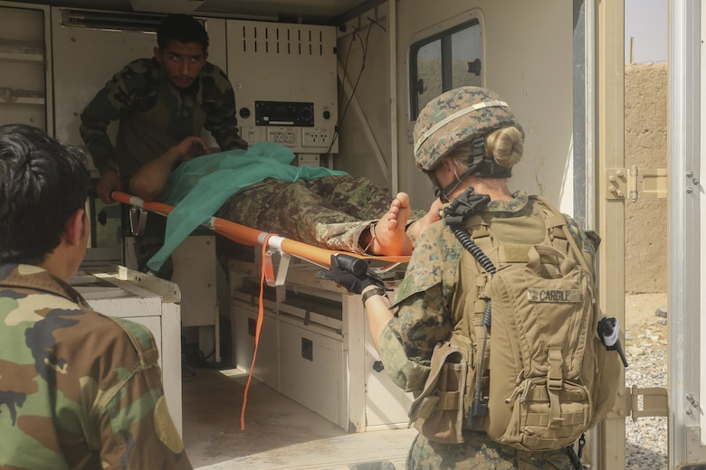 A U.S. Navy Sailor with Task Force Southwest and an Afghan National Army soldier with 2nd Brigade, 215th Corps prepare to evacuate a wounded ANA soldier at Camp Nolay, Afghanistan, May 23, 2017. Several Marine advisors assisted their Afghan counterparts with force sustainment improvements, as well as assisting in the coordination of a clearing operation to help thwart enemy presence in the Sangin District. (U.S. Marine Corps photo by Sgt. Lucas Hopkins)