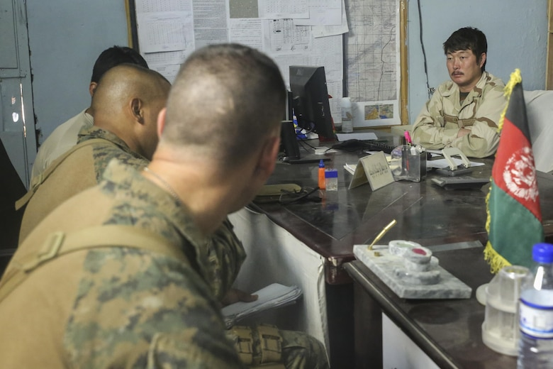 U.S. Marines assigned to Task Force Southwest speak with an Afghan National Army soldier with 2nd Brigade, 215th Corps at Camp Nolay, Afghanistan, May 24, 2017. Several Marine advisors assisted their Afghan counterparts during an expeditionary advising package May 21-25, providing force sustainment recommendations as well as assisting in the coordination of a clearing operation to help thwart enemy presence in the Sangin District. (U.S. Marine Corps photo by Sgt. Lucas Hopkins)