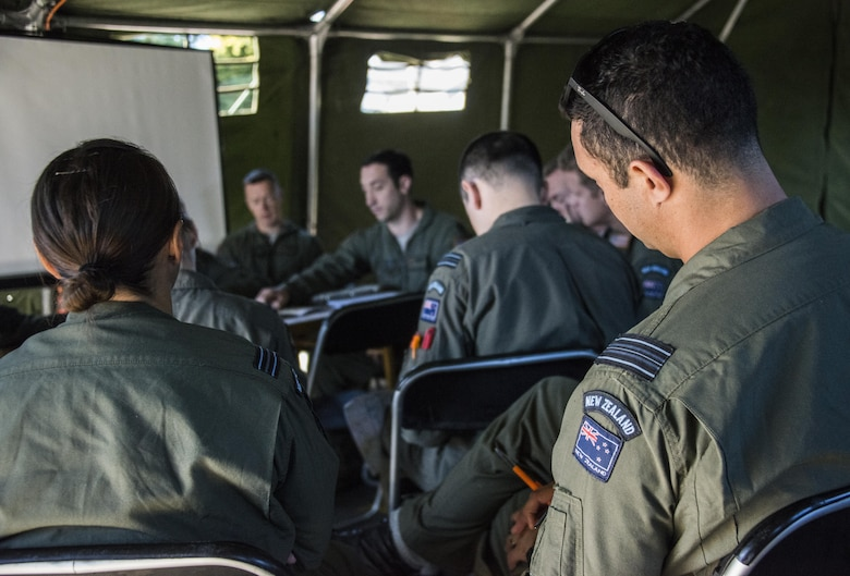 A U.S. Air Force 1st Special Operations Squadron evaluator navigator delivers a mission briefing to Royal New Zealand Air Force 40th Squadron and 1st SOS aircrew prior to formation flying operations, April 22, 2017 at RNZAF Base Woodbourne, New Zealand. The combined mission involving a formation flight with two U.S. Air Force MC-130s and one RNZAF C-130 demonstrated the strength of the alliance between the United States and New Zealand (U.S. Air Force photo by Capt. Jessica Tait)