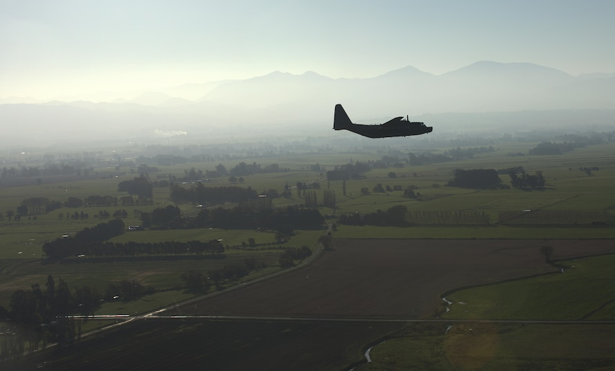 A U.S. Air Force 1st Special Operations Squadron MC-130H Combat Talon II flies in formation with a Royal New Zealand Air Force 40th Squadron C-130, April 22, 2017 at RNZAF Base Woodbourne, New Zealand. Executing airborne operations throughout Exercise Teak Net, the formation flight symbolized the strength of a partnership that has evolved over the years. (U.S. Air Force courtesy photo by Capt. Kevin Knutson)